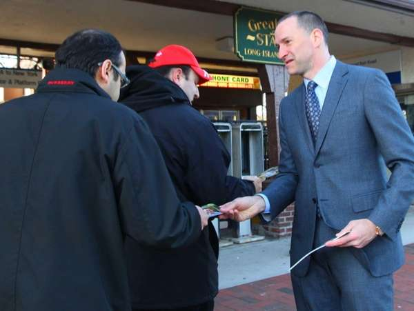Democratic Nassau County executive candidate Adam Haber greets