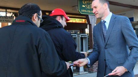 Democratic Nassau County executive candidate Adam Haber greets