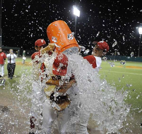Pierson-Bridgehampton pitcher Colman Vila is doused by water