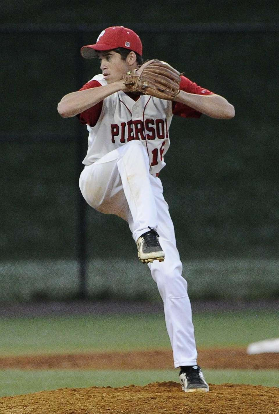 Pierson-Bridgehampton starting pitcher Colman Vila throws against Friends