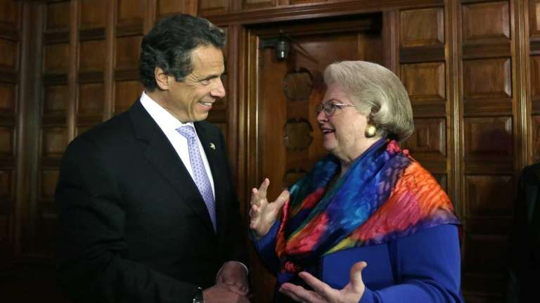 New York Gov. Andrew Cuomo, left, talks with