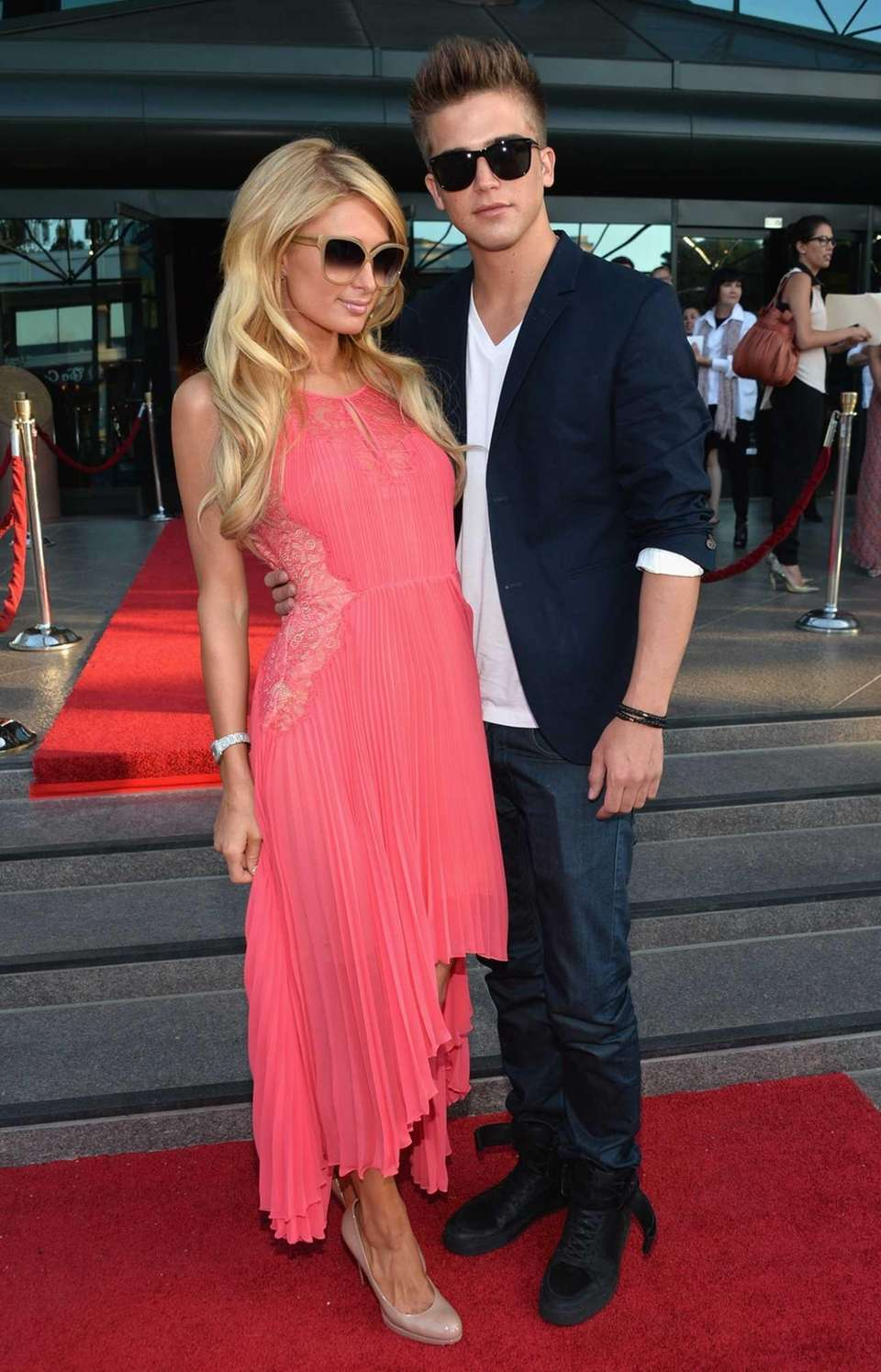 Paris Hilton stops to pose with model River