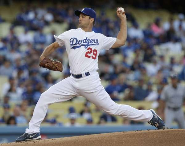 Dodgers starting pitcher Ted Lilly delivers to home