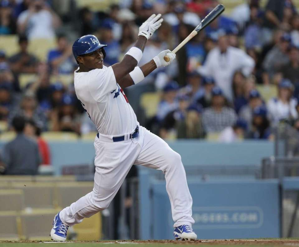 Dodgers outfielder Yasiel Puig follows through on a