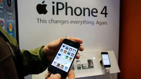 An AT&T customer tries out an Apple iPhone