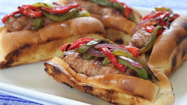 Grilled sausage, onions and peppers on grilled hot