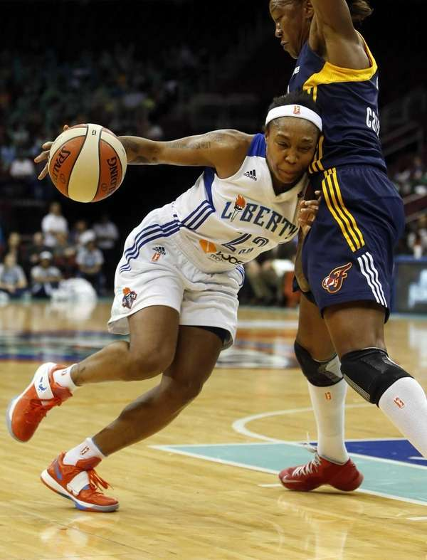 Cappie Pondexter drives against Indiana's Tamika Catchings during