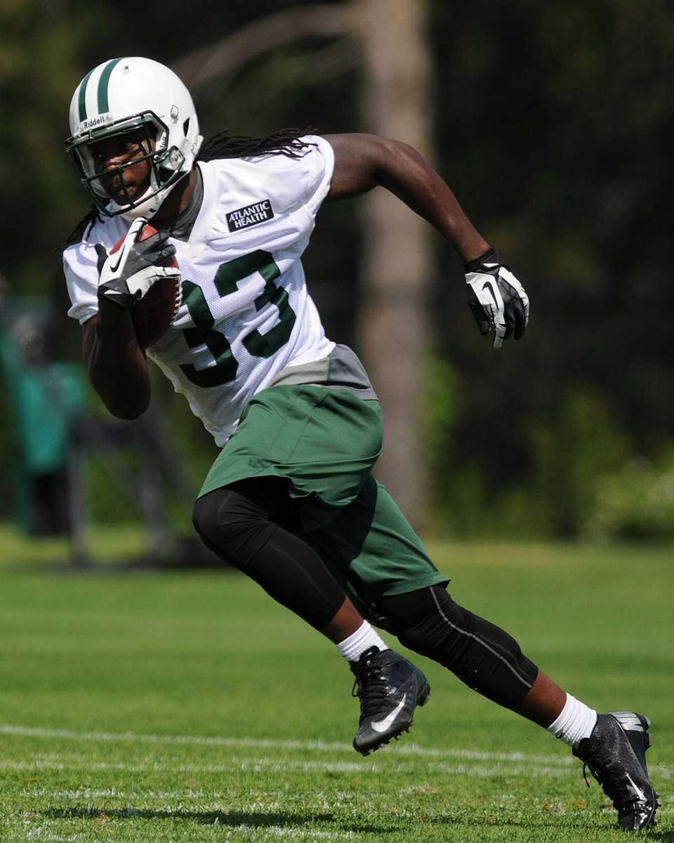 Jets running back Chris Ivory rushes during team