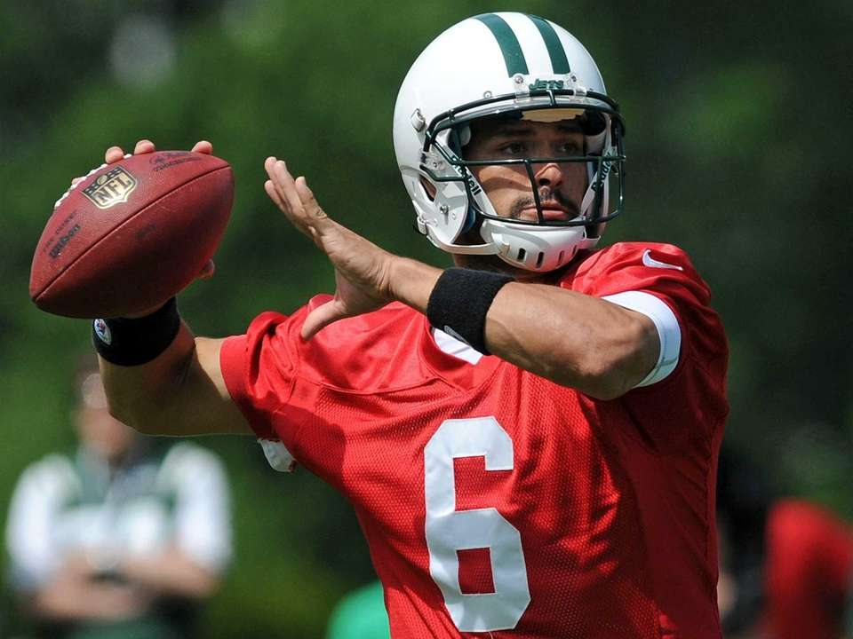 Jets quarterback Mark Sanchez throws a pass during