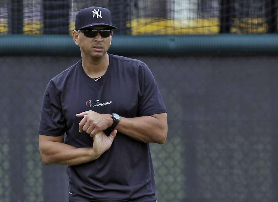 Yankees third baseman Alex Rodriguez stretches his wrist