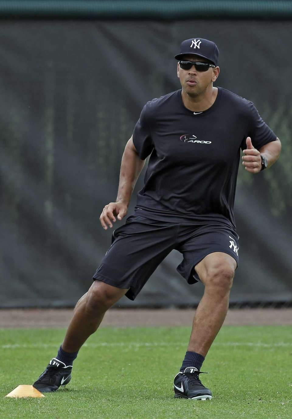 Yankees third baseman Alex Rodriguez runs drills during