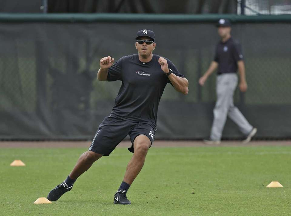 Yankees third baseman Alex Rodriguez runs through drills