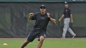 Yankees third baseman Alex Rodriguez runs through drills
