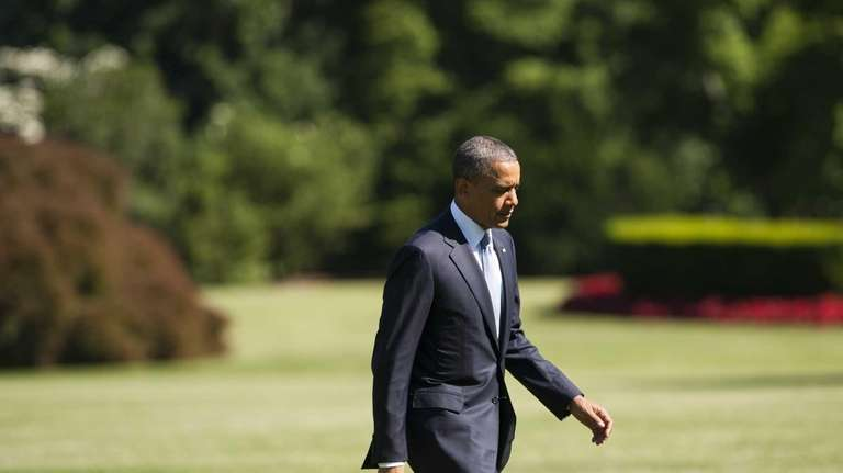 President Barack Obama walks across the South Lawn