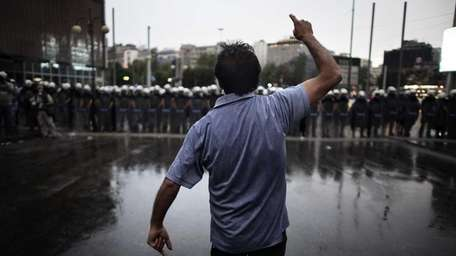 Protestors clash with Turkish riot policemen on the