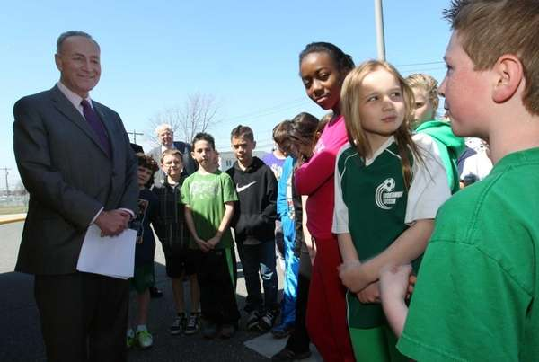 U.S. Senator Charles E. Schumer talks with children