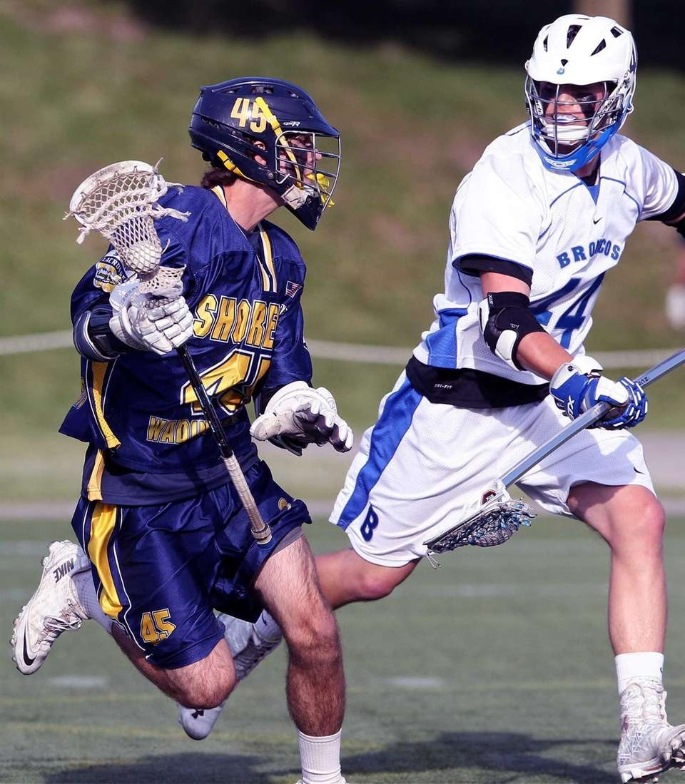 Shoreham-Wading River's Ryan Bray sets up a play