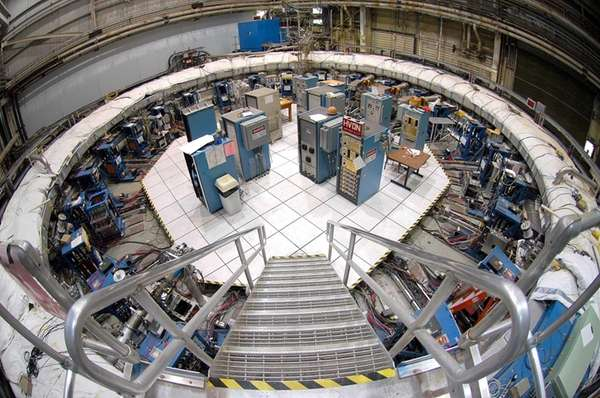 Physicists stand inside the Muon g-2 storage ring,
