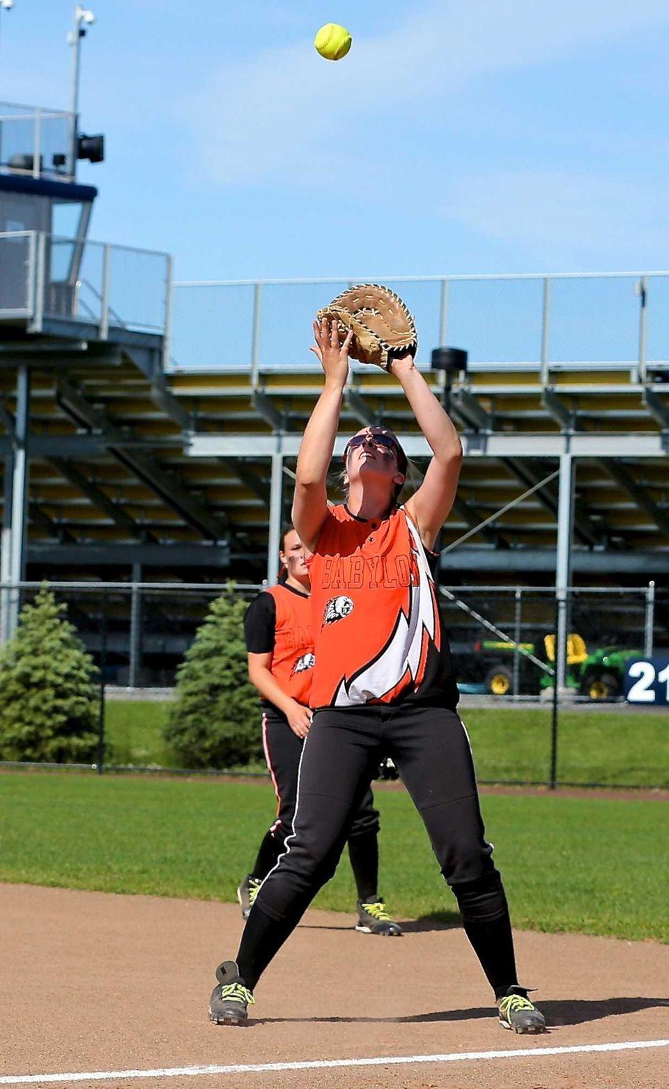 Babylon 1st baseman Mary Tighe grabs the pop