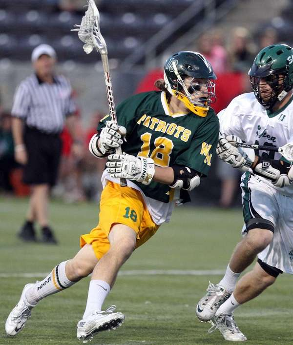 Ward Melville's Jack Bruckner gets the corner during