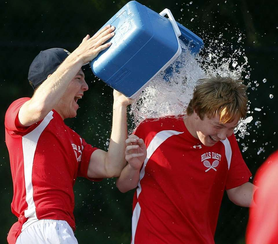Hills East's Travis Leaf gets a water bath