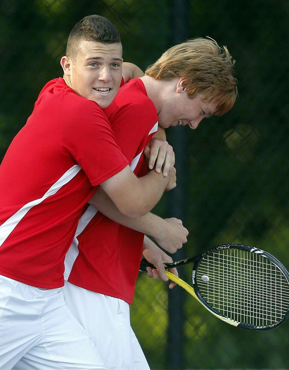 Hills East's Ross Reiffman gives his doubles partner
