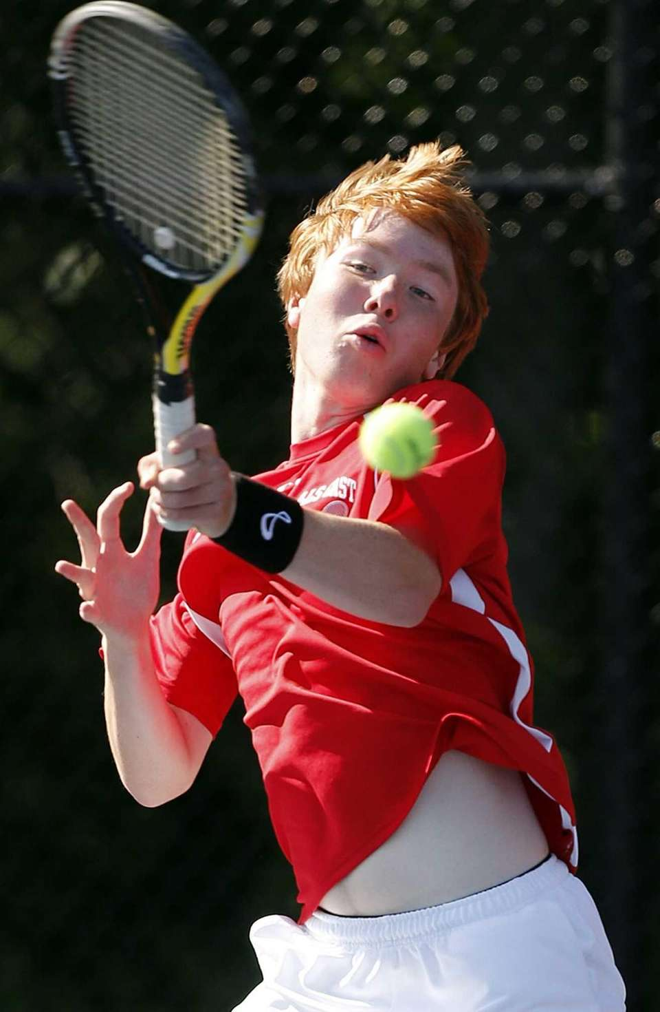Hills East's Travis Leaf hits a forehand return