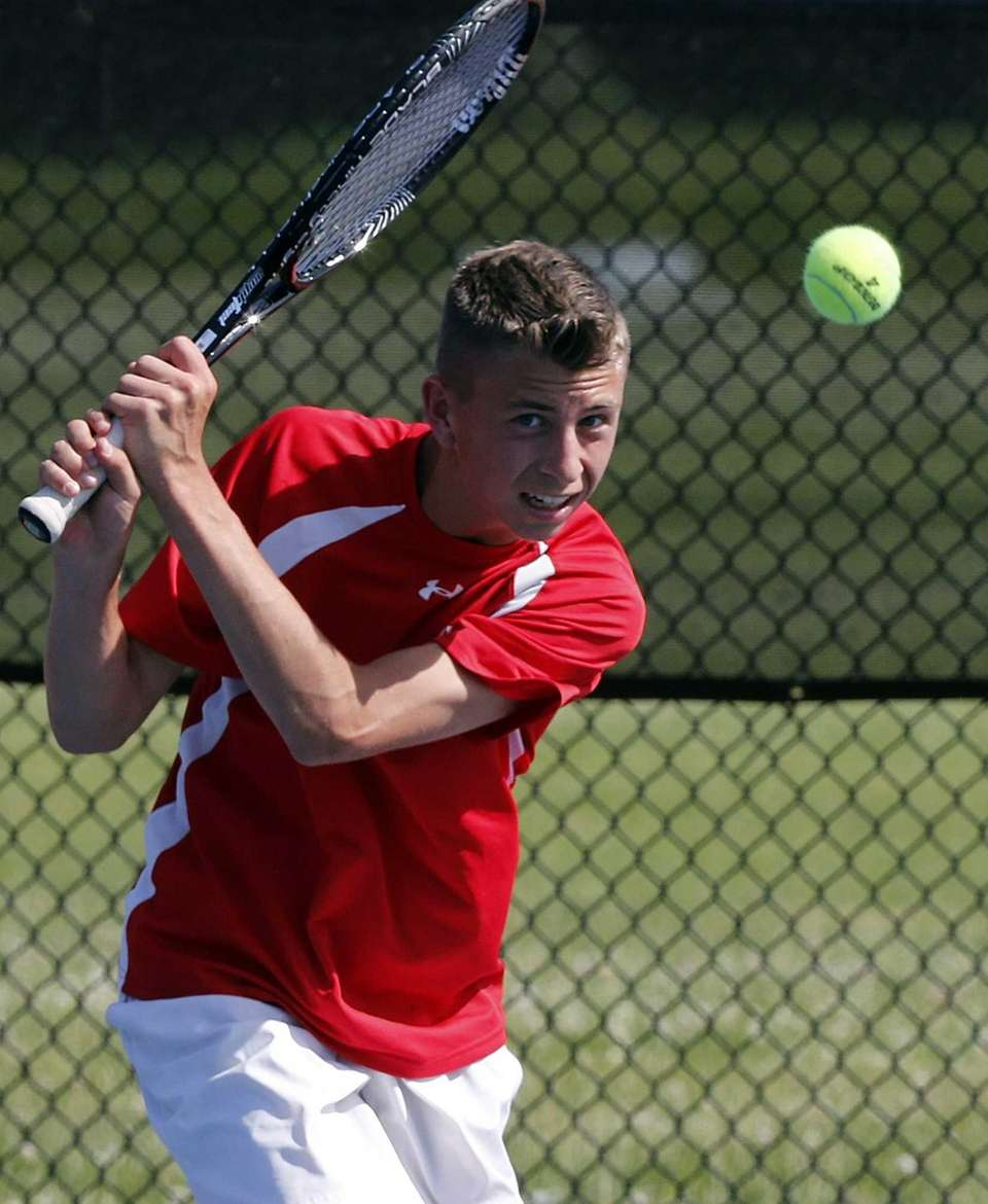 Hills East's Kyle Alper hits a backhand return