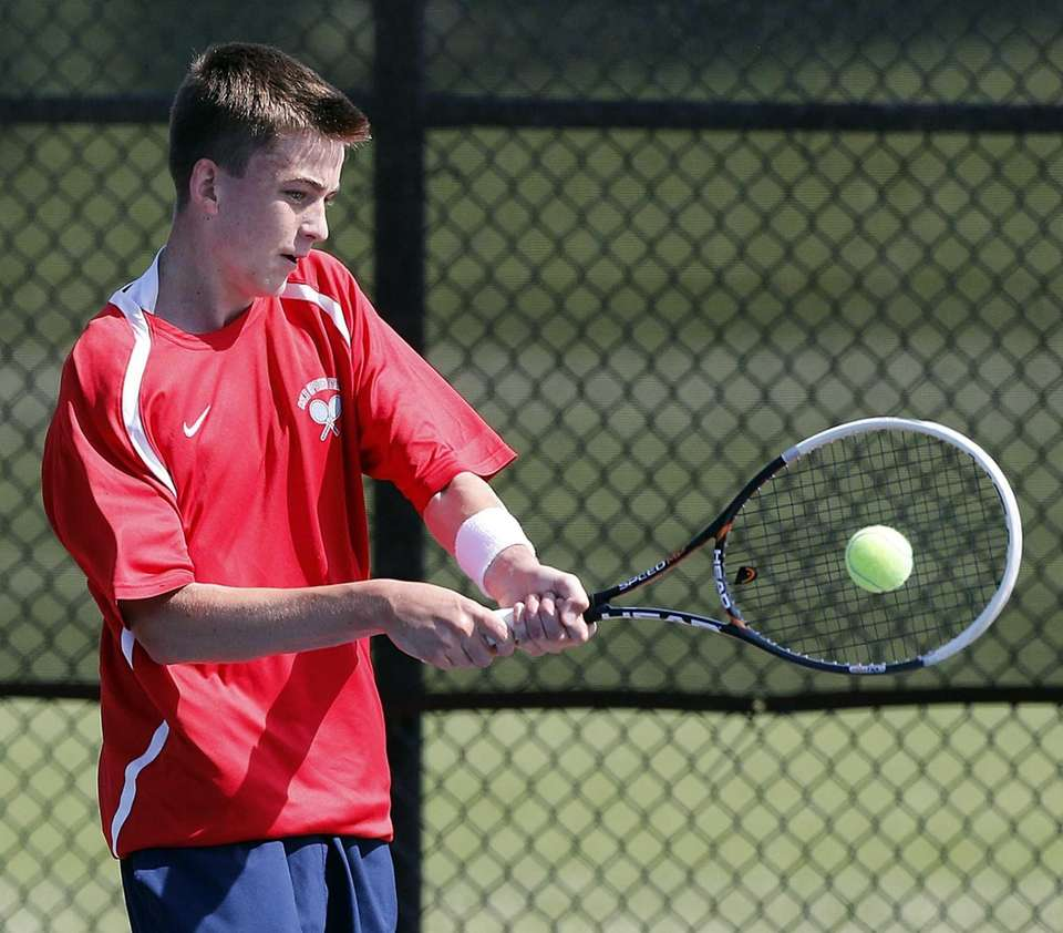Cold Spring Harbor's Conor Mullins with the backhand