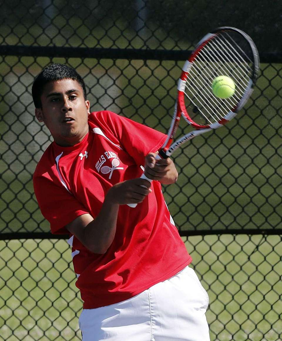 Hills East's Zain Ali hits a backhand return