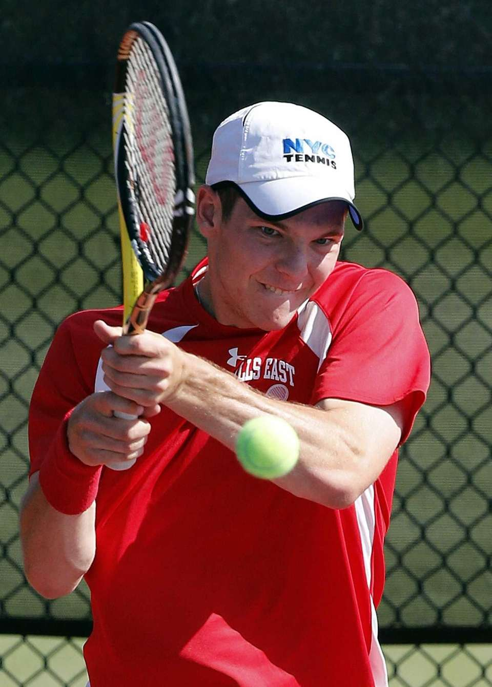 Hills East's Jeff Cherkin hits a backhand return
