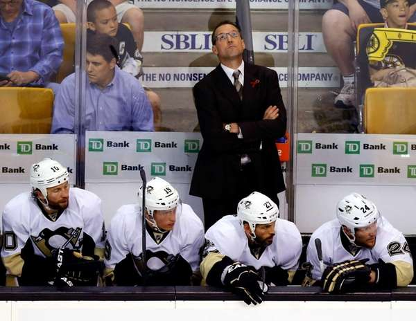 Dan Bylsma of the Pittsburgh Penguins looks at