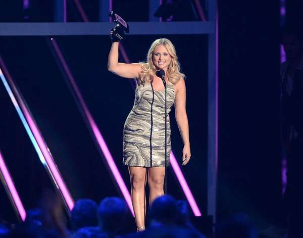Miranda Lambert accepts an award onstage during the
