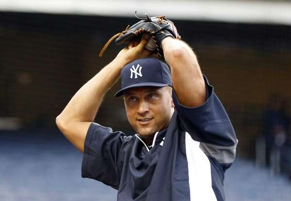 Derek Jeter plays catch during batting practice before