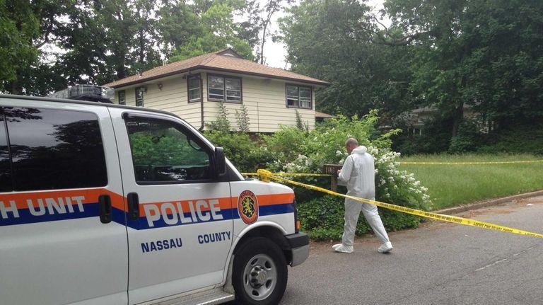 A Nassau County crime scene detective investigates at
