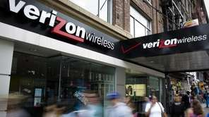 Pedestrians pass a Verizon Wireless store on Canal