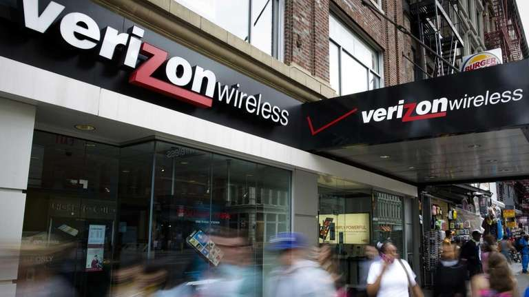 Pedestrians pass a Verizon Wireless store on Canal