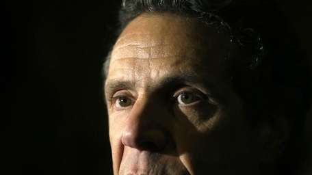 New York Gov. Andrew Cuomo talks to reporters