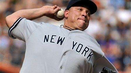 Yankees starting pitcher Bartolo Colon throws against the