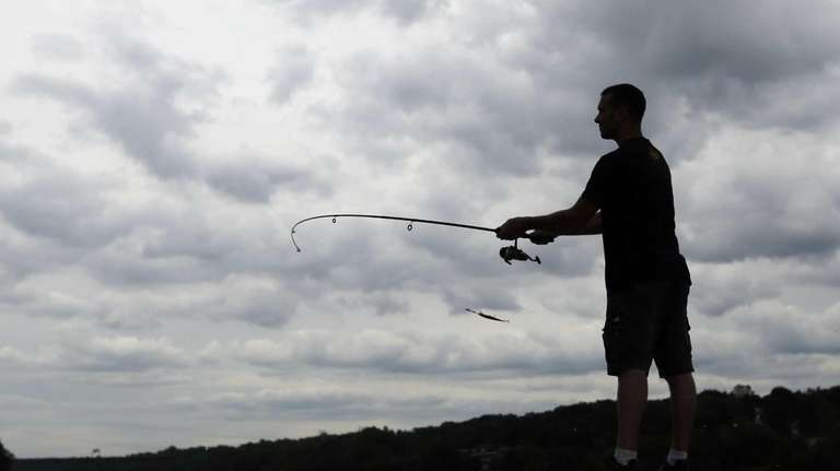 Steve Kenny of Little Rock, Ark., casts a