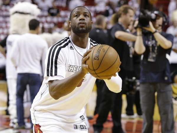 Dwyane Wade works on his shot before the