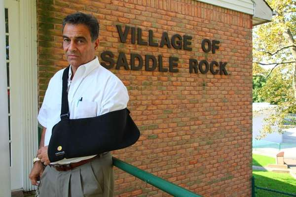 Saddle Rock Mayor Dr. Dan Levy stands in