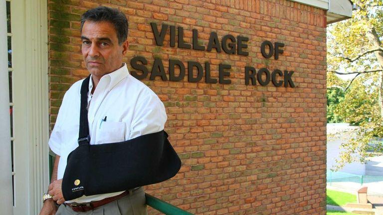 Saddle Rock Mayor Dr. Dan Levy stands in