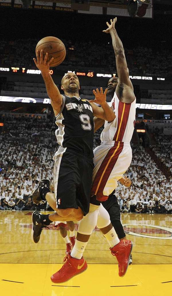Miami Heat center Joel Anthony defends against San