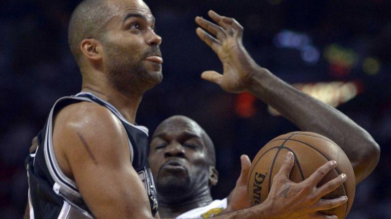 Tony Parker, left, of the San Antonio Spurs