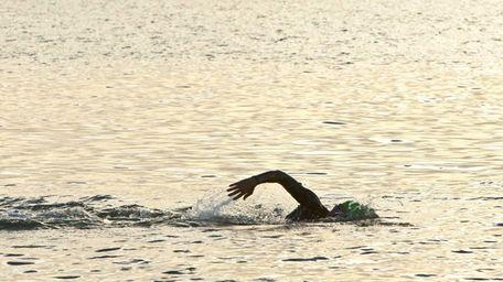 A swimmer in the water at Cedar Beach