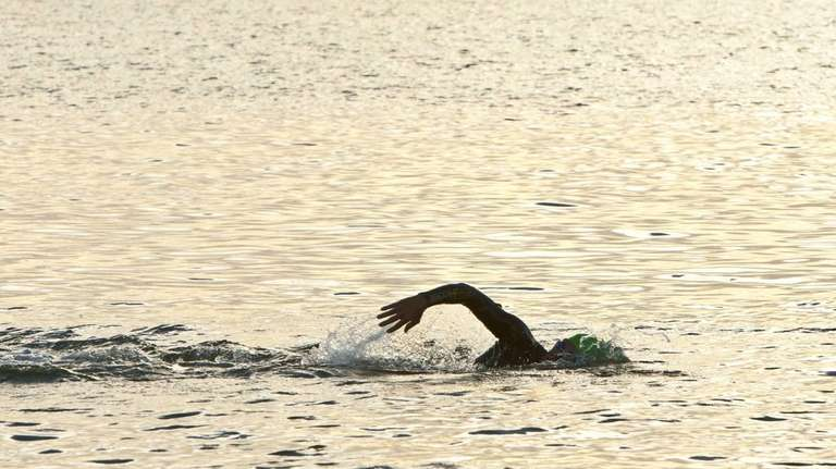 A swimmer in the water at Cedar Beach