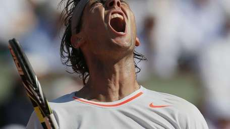 Spain's Rafael Nadal reacts shortly before defeating Serbia's