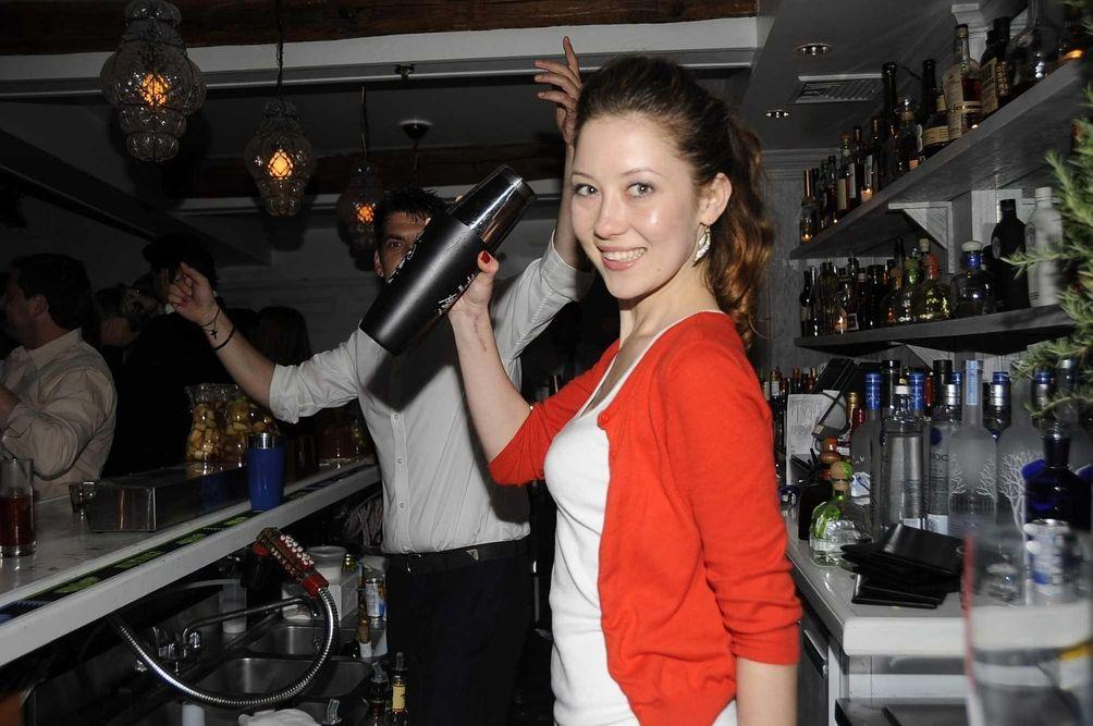 Bartender Katerina Biyanova shakes and mixes cocktails at