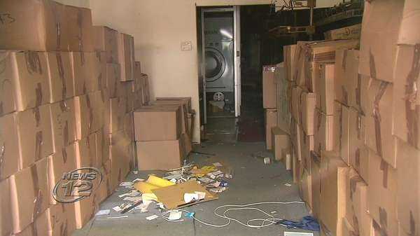 A storage company was holding the customers' clothes, but the items are now being returned to the store.